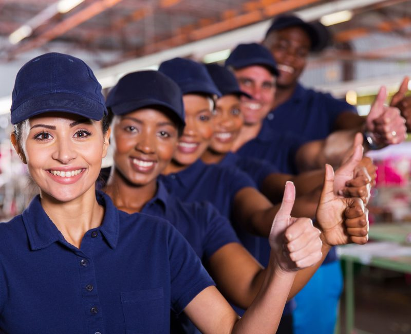 36871607 - cheerful textile workers team giving thumbs up